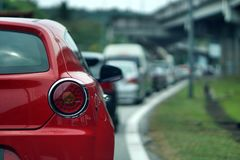A close up of red car on traffic jam at Gombak Kuala Lumpur. A traffic jam is a long line of vehicles that cannot move forward because there is too much traffic royalty free stock photography