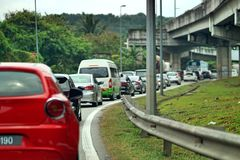 A close up of red car on traffic jam at Gombak Kuala Lumpur. A traffic jam is a long line of vehicles that cannot move forward because there is too much traffic stock images