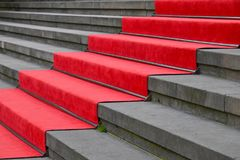Red carpet over concrete stairs perspective. Close up red carpet over grey concrete stairs perspective ascending, low angle side view Stock Photography