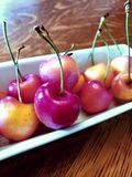 Close up on red cherries in a bunch royalty free stock images