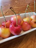 Close up on red cherries in a bunch stock images