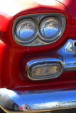 Close up red Chevrolet Pick-up Truck. Close up of headlights on Chevrolet 1956 pick up truck red Royalty Free Stock Photo