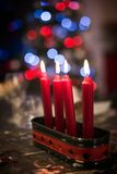 Close-up of red christmas advent candles on a table, bokeh lights Royalty Free Stock Photography