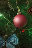 Close up Red Christmas Ball. On Holiday Fir-Tree. Background in Vertical Position for Christmas and New Year Stock Images