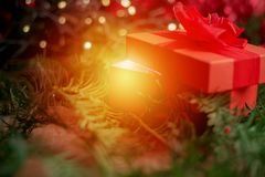 Close up on red christmas box gift, magicial effect Stock Photo