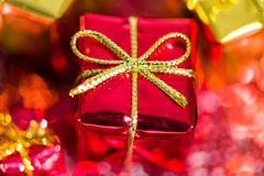 Close up of a red Christmas gift with golden ribbon.  Stock Photography