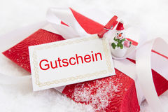 Close up of red christmas present box with German text Royalty Free Stock Photo