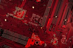 Close up of red circuit plate. Beautiful  red and black lines for  background Royalty Free Stock Photo