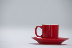 Close-up red coffee cup and saucer Royalty Free Stock Photos