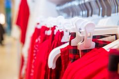 Close up red color Clothes on hangers in shop, butique. Make Outfit set. Shopping Mall. Shopper. Sales. Shopping Center. Selective. Focus. space for text Stock Image