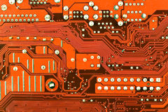 Close up of red computer circuit board Royalty Free Stock Photo