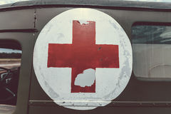 Close up of a red cross on a vintage army Royalty Free Stock Image
