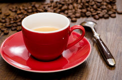 Close up red cup of espresso coffee. With spoon and beans Stock Photography