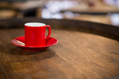 Close-up of red cup and saucer on table Royalty Free Stock Photos