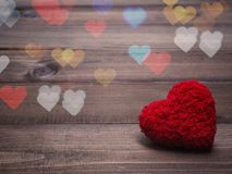 Red cushion heart shape on wood background stock images