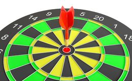 Close up red dart arrow on center of dartboard. 3d illustration Royalty Free Stock Photo