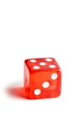 Close up of a red dice on white background Royalty Free Stock Photography