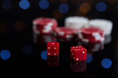 Close-up of red dices with chips Stock Photography