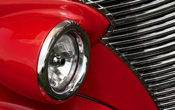 Red fender and grill on an antique car. A close up of a red fender, headlight and grill of a classic antique car Stock Photography