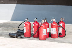 Close up red fire extinguisher on the ground. October 31, 2016 Stock Photos