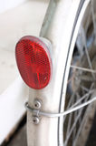 Close up of red glass Reflector part of bicycle. Vintage bicycle Royalty Free Stock Photo