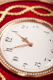 Close-up of red and gold antique tambour clock Royalty Free Stock Photo