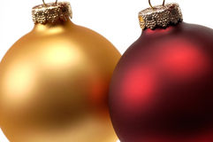 Close up of a red and a gold Christmas ornament / bauble. This stock photo is a close up view of two Christmas ornament / bauble / balls Royalty Free Stock Images