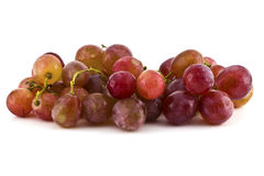 Close up of red grapes on white background Royalty Free Stock Photography