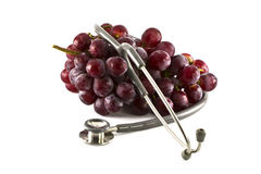 Close up of red grapes on white background Royalty Free Stock Images