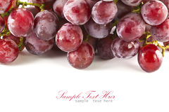 Close up of red grapes on white background Royalty Free Stock Image