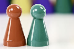 Close up with red and green pawns Royalty Free Stock Photos