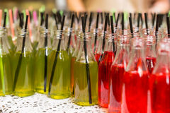 Close Up of Red and Green Sodas with Black Straws Stock Images