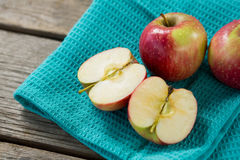 Close-up of red halved apples kept on cloth Royalty Free Stock Photo