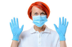 Close up of red headed nurse wearing face mask Royalty Free Stock Images