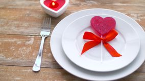 Close up of red heart shaped lollipop on plate stock video