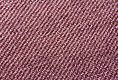 Close-up of red jeans cloth. Stock Photo