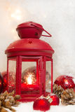 Close up of red lantern with balls and cones for christmas - greeting card first advent Stock Photography