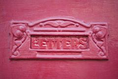 Close Up Of Red Letterbox. In Wooden Door Stock Photography