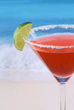 Close up red Martini cocktail on the beach Stock Photos