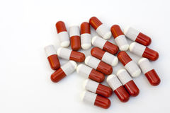 Close up of red medical capsules isolated on white background Stock Image