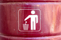 Close up red metal garbage bin with white sign on Stock Image