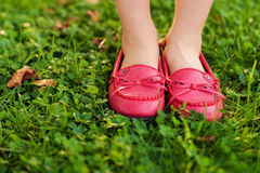 Close up of red moccasins on child's feet Royalty Free Stock Photography