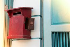 Close up of red old vintage wooden mailbox in front of vintage store. stock photo