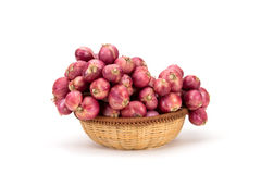 Close up red onion or shallots in wooden basket Stock Photos