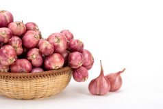 Close up red onion or shallots in wooden basket Royalty Free Stock Photos