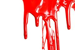 Close up of red paint. Flows of red glossy paint close-up on white background stock photo