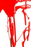 Close up of red paint. Flows of red glossy paint close-up on white background stock photography