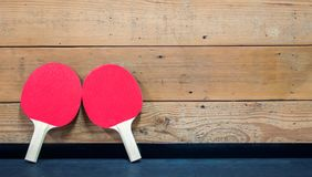 2 ping pong paddles against a wooden wall Stock Images