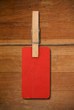 Close up of red post it reminders and clothespins Royalty Free Stock Photo