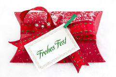 Close up of red present box with German text for christmas - coupon for a gift Stock Photography